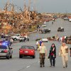 Residents of Joplin, Mo, walk west on 26th Street near Maiden Lane after a tornado hit the southwest Missouri city on Sunday evening, May 22, 2011. The tornado tore a path a mile wide and four miles long destroying homes and businesses. (AP Photo/Mike Gullett) ORG XMIT: MOMG101