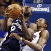 Memphis Grizzlies\' Tony Allen, front, eyes the basket as Oklahoma City Thunder\'s Kevin Durant, rear, defends during the first half of Game 2 of their Western Conference Semifinals NBA basketball playoff series in Oklahoma City, Tuesday, May 7, 2013. (AP Photo/Alonzo Adams)