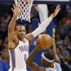 Oklahoma City\'s Russell Westbrook (0) defends on Denver\'s Ty Lawson (3) during the NBA basketball game between the Oklahoma City Thunder and the Denver Nuggets at the Chesapeake Energy Arena on Wednesday, Jan. 16, 2013, in Oklahoma City, Okla. Photo by Chris Landsberger, The Oklahoman