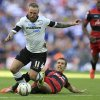 Photo - Derby County's Johnny Russell, left, is fouled by Queens Park Rangers' Gary O'Neil  during the English Championship Play Off Final at Wembley Stadium, London Saturday May 24, 2014. The winner of the match gain promotion to the English Premier League next season. O'Neil was sent off for the tackle. (AP Photo/Mike Egerton/PA) UNITED KINGDOM OUT
