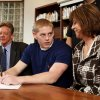 Norman North football player Brenden Brown, surrounded by parents Dale and Christine, , signs a letter of intent to play college football n the high school\'s library on Wednesday, Feb 3, 2010, in Norman, Okla. Photo by Steve Sisney, The Oklahoman