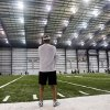 Photo - New Orleans Saints head coach Sean Payton watches quarterbacks work out after NFL football practice at the team's training facility in Metairie, La., Tuesday, June 11, 2013. (AP Photo/Gerald Herbert)