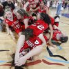 Fort Gibson\'s Nana Wallace, front, celebrates with her teammates after the 52-51 overtime win over Cache during the championship game of the 4A girls state championship tournament at the Big House in the State Fair Park on Saturday, March 12, 2011, in Oklahoma City, Okla. Photo by Chris Landsberger, The Oklahoman