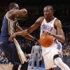 Photo - Oklahoma City's Kevin Durant (35) tries to get around Utah's Josh Howard (8) during an NBA game between the Oklahoma City Thunder and the Utah Jazz at Chesapeake Energy Arena in Oklahoma CIty, Tuesday, Feb. 14, 2012. Photo by Bryan Terry, The Oklahoman