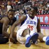 Photo - Charlotte Bobcats' Michael Kidd-Gilchrist, left, and Philadelphia 76ers' Henry Sims wrestle for a loose ball during the first half of an NBA basketball game, Wednesday, April 2, 2014, in Philadelphia. (AP Photo/Matt Slocum)