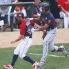 Photo - United States' pitcher Daniel Norris, left, forces out World's Steven Moya, right, at first base during the second inning of the All-Star Futures baseball game, Sunday, July 13, 2014, in Minneapolis. (AP Photo/Paul Sancya)