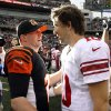 Cincinnati Bengals quarterback Andy Dalton (14) meets with New York Giants quarterback Eli Manning (10) after the Bengals\' 31-13 win in an NFL football game, Sunday, Nov. 11, 2012, in Cincinnati. (AP Photo/Tom Uhlman)