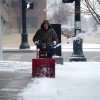 Dean Stratton works to remove snow on the sidewalk around Fifth Third Bank while working for VIOX Services in Evansville Evansville, Ind., Tuesday, Feb. 4, 2014. A Winter Storm Warning was issued Tuesday as a mixture of snow, sleet and rain continued into the evening with temperatures around 30 degrees. (AP Photo/The Evansville Courier & Press, Jason Clark)