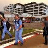 Photo - Hospital workers walk away from the Joplin Regional Medical Center in Joplin, Mo., Sunday, May 22, 2011. A large tornado moved through much of the city, damaging the hospital and hundreds of homes and businesses. (AP Photo/Mark Schiefelbein)