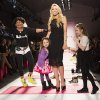 Designer Betsey Johnson, left, greets the audience with members of her family following a showing of her Fall 2013 collection during Fashion Week in New York, Monday, Feb. 11, 2013. (AP Photo/John Minchillo)