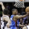 Oklahoma City Thunder\'s Russell Westbrook takes a shot past New Jersey Nets\' Kris Humphries during the first quarter of an NBA basketball game in Newark, N.J., Saturday, Jan. 21, 2012. (AP Photo/Mel Evans) ORG XMIT: NJME118