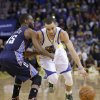 Golden State Warriors' Stephen Curry (30) drive past Charlotte Bobcats' Kemba Walker (15) during the second half of an NBA basketball game in Oakland, Calif., Tuesday, Feb. 4, 2014. The Bobcats won 91-75. (AP Photo/Tony Avelar)