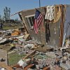 Louise McDaniel\'s home has an American Flag at the front as residents cleanup following Tuesday\'s deadly tornado on Wednesday, May 25, 2011, in Chickasha, Okla. Louise was with her hospitalized son Ronnie McDaniel in Oklahoma City when the tornado destroyed her home. Louise McDaniel saw the destruction and recognized her yard from aerial television coverage. Photo by Steve Sisney, The Oklahoman
