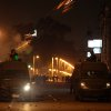 Egyptian riot police fire tear gas at protesters demonstrating in front of the presidential palace in Cairo, Egypt, Friday, Feb. 1, 2013. Thousands of protesters denouncing Egypt\'s Islamist president marched on his palace in Cairo on Friday, clashing with security forces firing tear gas and water cannons in the eighth day of the country\'s wave of political violence. (AP Photo/Khalil Hamra)