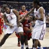 Courtney Paris and Amanda Thompson combine to block a shot by Keishia Hines in the first half as the University of Oklahoma plays Louisville at the 2009 NCAA women\'s basketball tournament Final Four in the Scottrade Center in Saint Louis, Missouri on Sunday, April 5, 2009. Photo by Steve Sisney, The Oklahoman