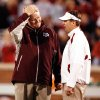 Head coaches Mike Sherman and Bob Stoops meet before the college football game between the University of Oklahoma Sooners (OU) and the Texas A&M at the Gaylord Familiy-Oklahoma Memorial Stadium on Saturday, Oct. 31, 2009, in Norman, Okla. Photo by Steve Sisney, The Oklahoman