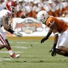 Oklahoma\'s Jamell Fleming (32) intercepts a pass beside Texas\' Mike Davis (1) during the Red River Rivalry college football game between the University of Oklahoma Sooners (OU) and the University of Texas Longhorns (UT) at the Cotton Bowl in Dallas, Saturday, Oct. 8, 2011. Oklahoma won 55-17. Photo by Bryan Terry, The Oklahoman