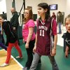 Former Farris student Druid Gibson wears a jersey from her old school while participating in a game of dodgeball during a P.E. class in the Lane School gymnasium on her first day of classes in her new school. About 50 students transferred to Lane Public School after their former school, Farris School, was annexed by Lane in Atoka County. Photo taken March 1, 2013. Photo by Jim Beckel, The Oklahoman