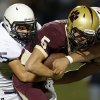 Minco\'s Ringo Garrett brings down Cashion\'s Matt Harman during their high school football game in Cashion, Okla., Friday, Sept. 27, 2013. Photo by Bryan Terry, The Oklahoman