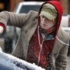 Joseph Rosser of Oklahoma City clears his car windows of ice as a winter storm moves into the area on Thursday, Jan. 28, 2010, in Norman, Okla. Photo by Steve Sisney, The Oklahoman