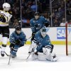 Photo - San Jose Sharks goalie Antti Niemi (31), of Finland, deflects a shot on goal next to Boston Bruins' Ryan Spooner, left, during the second period of an NHL hockey game on Saturday, Jan. 11, 2014, in San Jose, Calif. (AP Photo/Marcio Jose Sanchez)