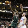 Philadelphia 76ers\' Spencer Hawes (00) blocks a shot by Milwaukee Bucks\' Larry Sanders (8) in the first half of an NBA basketball game, Monday, Nov. 12, 2012, in Philadelphia. (AP Photo/Matt Slocum)