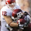 Photo - TACKLE: OU's Austin Box tackles Mike Goodson of Texas A&M during the college football game between the University of Oklahoma and Texas A&M University at Kyle Field in College Station, Texas, Saturday, November 8, 2008.  BY BRYAN TERRY, THE OKLAHOMAN   ORG XMIT: KOD