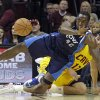 Dallas Mavericks\' Elton Brand (42) flips a loose ball away from Cleveland Cavaliers\' Anderson Varejao, from Brazil, in the first quarter of an NBA basketball game on Saturday, Nov. 17, 2012, in Cleveland. (AP Photo/Mark Duncan)