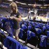 Kelly Curry puts t-shirts on chairs in preparation for the first game of the NBA basketball finals at the Chesapeake Arena on Tuesday, June 12, 2012 in Oklahoma City, Okla. Photo by Steve Sisney, The Oklahoman