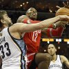 Photo - Memphis Grizzlies center Marc Gasol (33), of Spain, fouls Houston Rockets center Dwight Howard (12) in the first half of an NBA basketball game, Saturday, Jan. 25, 2014, in Memphis, Tenn. (AP Photo/Lance Murphey)