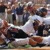 Oklahoma State\'s Joseph Randle (1) scores a touchdown during first half of a college football game between the Oklahoma State University Cowboys (OSU) and the University of Texas Longhorns (UT) at Darrell K Royal-Texas Memorial Stadium in Austin, Texas, Saturday, Oct. 15, 2011. Photo by Sarah Phipps, The Oklahoman
