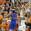 Oklahoma State \'s Marcus Smart (33) blocks a shot by Kansas\' Elijah Johnson (15) during the college basketball game between the Oklahoma State University Cowboys (OSU) and the University of Kanas Jayhawks (KU) at Gallagher-Iba Arena on Wednesday, Feb. 20, 2013, in Stillwater, Okla. Photo by Chris Landsberger, The Oklahoman