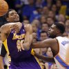 Los Angeles\' Andrew Bynum passes the ball away from Oklahoma City\'s Nazr Mohammed during Game 2 in the second round of the NBA playoffs between the Oklahoma City Thunder and the L.A. Lakers at Chesapeake Energy Arena on Wednesday, May 16, 2012, in Oklahoma City, Oklahoma. Photo by Chris Landsberger, The Oklahoman