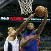 Detroit Pistons\' Andre Drummond, right, makes a shot despite defensive effort by Orlando Magic\'s Gustavo Ayon, left, of Mexico, during the first half of an NBA basketball game, Wednesday, Nov. 21, 2012, in Orlando, Fla. (AP Photo/John Raoux)