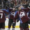 Colorado Avalanche center John Mitchell, left, congratulates center Matt Duchene, second from left, as members of the Aalanche celebrate a 6-2 victory over the Chicago Blackhawks in an NHL hockey game in Denver on Friday, March 8, 2013. Chicago\'s loss was the first for the team in regulation this season. (AP Photo/David Zalubowski)