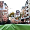 Demonstrators march with posters showing victims of a far-right terror group in Hamburg, northern Germany, Sunday Nov. 4, 2012. Anti-racism campaigners are staging vigils across Germany to commemorate the victims of a far-right terror group whose existence came to light a year ago. Organizers called memorial events in two dozen cities Sunday to remember the victims of the National Socialist Underground. The group is suspected of killing at least nine men and a police officer during a seven-year murder spree that began in 2000. (AP Photo/dapd/Sven Klein)