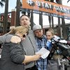 From left to right, Jill Haro, aunt, Robert Preece, father, and Robert Preece Jr., brother, and Diana Denver, mother, of Los Angeles Dodgers fan Jonathan Denver, make a public plea for witnesses to the fatal stabbing Wednesday of Jonathan Denver, Sunday, Sept. 29, 2013, outside the stadium before the Giants\' baseball game Sunday in San Francisco. Jonathan Denver, 24, was stabbed Wednesday during a melee following a game between the Giants and the Los Angeles Dodgers. (AP Photo/Tony Avelar)