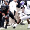 Oklahoma State\'s Joseph Randle (1) dives for a first down in front of TCU\'s Keivon Gamble (16) during a college football game between Oklahoma State University (OSU) and Texas Christian University (TCU) at Boone Pickens Stadium in Stillwater, Okla., Saturday, Oct. 27, 2012. Photo by Sarah Phipps, The Oklahoman