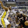 Miami Heat\'s LeBron James, right, is defended by Indiana Pacers\' Sam Young during the first half of Game 3 of the NBA Eastern Conference basketball finals in Indianapolis, Sunday, May 26, 2013. (AP Photo/Nam H. Huh)