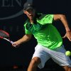 Photo - Dominic Thiem, of Austria, returns a shot against returns a shot against Ernests Gulbis, of Latvia, during the second round of the 2014 U.S. Open tennis tournament, Friday, Aug. 29, 2014, in New York. (AP Photo/John Minchillo)