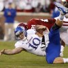 KU\'s Dayne Crist (10) fumbles the ball as OU\'s Tom Wort (21) brings hits him during the college football game between the University of Oklahoma Sooners (OU) and the Kansas Jayhawks (KU) at Gaylord Family-Oklahoma Memorial Stadium in Norman, Okla., Saturday, Oct. 20, 2012. Photo by Bryan Terry, The Oklahoman