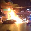 Photo - Smoke and flames billow from a burning vehicle following a shooting and multi-car accident on the Las Vegas Strip in Las Vegas early Thursday, Feb. 21, 2013.  The Las Vegas Strip became a scene of deadly violence early Thursday when, authorities say, someone in a black Range Rover opened fire on a Maserati, sending it crashing into a taxi that burst into flames, leaving three people dead and at least six injured. (AP Photo/Erik Lackey)