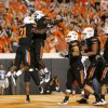 Oklahoma State\'s Jeremy Smith celebrates with Kye Staley after Smith scored a touchdown Thursday. BY BRYAN TERRY, The Oklahoman