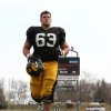 Photo - Iowa center Austin Blythe leaves the field after the NCAA college football team's practice Saturday, April 12, 2014, at Valley High Stadium in West Des Moines, Iowa. (AP Photo/The Des Moines Register, Bryon Houlgrave) MAGS OUT  NO SALES   TV OUT  MANDATORY CREDIT