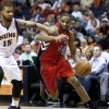 Toronto Raptors\' Alan Anderson (6) drives against Phoenix Suns\' Marcus Morris (15) during the first half of an NBA basketball game, Wednesday, March 6, 2013, in Phoenix. (AP Photo/Matt York)