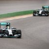 Photo - Mercedes driver Lewis Hamilton of Britain, left, and teammate Nico Rosberg of Germany steer their cars during the qualifying session ahead of Sunday's Belgian Formula One Grand Prix in Spa-Francorchamps, Belgium, Saturday, Aug. 23, 2014. Mercedes driver Nico Rosberg of Germany starts on pole position, Mercedes driver Lewis Hamilton of Britain placed second and Red Bull driver Sebastian Vettel of Germany third. (AP Photo/Geert Vanden Wijngaert)