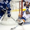 New York Islanders goaltender Evgeni Nabokov, right, makes a save on Toronto Maple Leafs left winger James van Riemskyk during the second period of an NHL hockey game, Thursday, Jan. 24, 2013, in Toronto. (AP Photo/The Canadian Press, Frank Gunn)