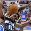 Orlando Magic guard Ish Smith, right, is folded as he dunks by Los Angeles Clippers guard Jamal Crawford during the first half of their NBA basketball game, Saturday, Jan. 12, 2013, in Los Angeles. (AP Photo/Mark J. Terrill)