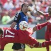 Photo - San Jose Earthquakes' Alan Gordon, center,  concedes a penalty as he fouls Toronto FC's Nick Hagglund (17) during first half MLS action in Toronto on Saturday June 7, 2014. (AP Photo/The Canadian Press, Chris Young)
