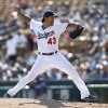 Los Angeles Dodgers pitcher Brandon League throws against the Texas Rangers in the seventh inning during a spring exhibition baseball game in Glendale, Ariz., Friday, March 7, 2014. (AP Photo/Paul Sancya)